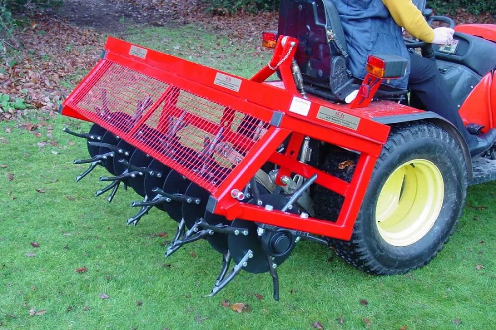 "Towed Plug Aerator | 60"" D Turf Care System"
